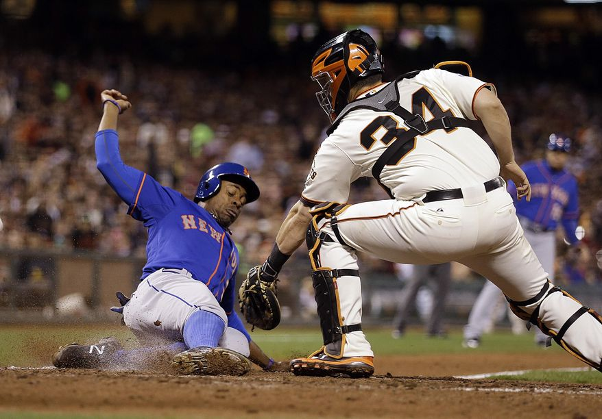 New York Mets' Curtis Granderson, left, is tagged out by San Francisco Giants catcher Andrew Susac during the sixth inning of a baseball game Tuesday, July 7, 2015, in San Francisco. Granderson was attempting to score on a fly ball hit by New York Mets third baseman Ruben Tejada. (AP Photo/Ben Margot)