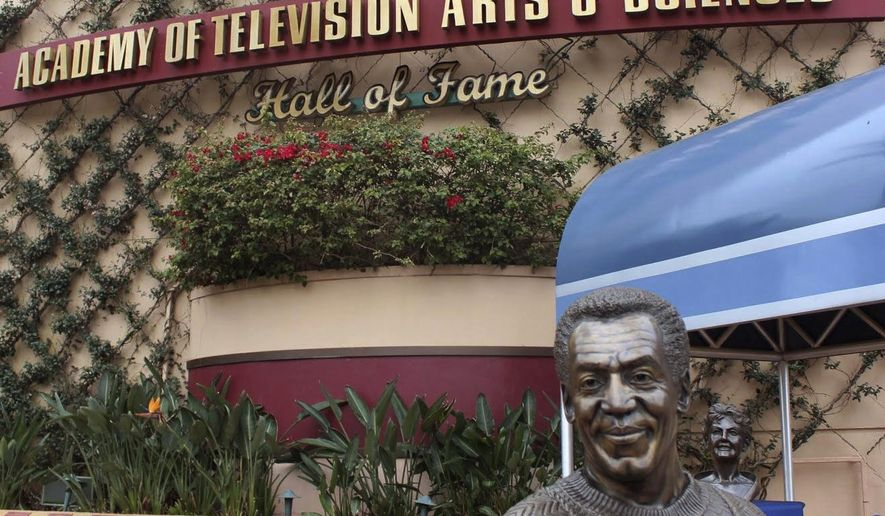 In this Feb. 26, 2015 photo, a bust of actor and comedian Bill Cosby is on display at Hollywood Studios theme park in Orlando, Fla. Local news outlets reported that Walt Disney World officials removed the bust from the park late Tuesday, July 7, 2015. The removal of the statue came after court documents unsealed on Monday revealed that Cosby testified in 2005 that he obtained Quaaludes with the intent of giving them to women he wanted to have sex with. (AP Photo/Patrick Mairs)