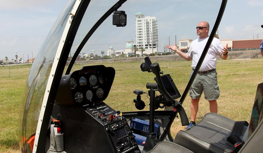 In this photo taken on July 7, 2015, Steve Olive, president of Oasis Services, which owns Galveston Helicopters, talks about the location at Stewart Beach where he'll be flying sightseeing tours of Galveston, Texas. (Jennifer Reynolds/The Galveston County Daily News via AP) MANDATORY CREDIT