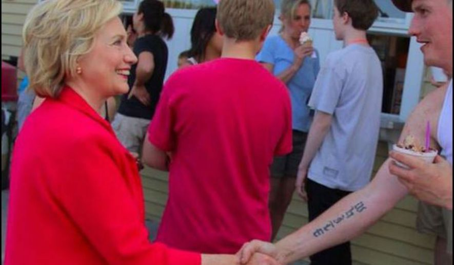 Hillary Clinton shakes hands with a man in the White Mountains region of New Hampshire. The campaign posted and then quickly deleted the photograph.