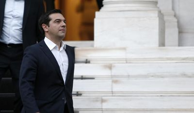 Greece's Prime Minister Alexis Tsipras leaves from Maximos Mansion to meet the Greek President Prokopis Pavlopoulos in Athens, Wednesday, July 8, 2015. (AP Photo/Petros Karadjias)