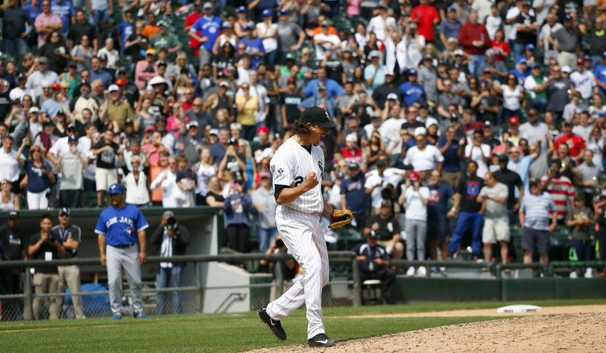 Chicago White Sox starting pitcher Jeff Samardzija (29) reacts to throwing a complete game during the ninth inning of a baseball game against the Toronto Blue Jays in Chicago, on Thursday, July 9, 2015. The White Sox won the game 2-0.  (AP Photo/Jeff Haynes)