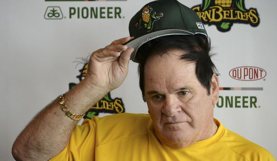"""Pete Rose ponders a question during a news conference at the CornCrib in Normal, Ill., Thursday, July 9, 2015. Rose said he's """"open to almost anything"""" that Commissioner Rob Manfred might have in mind when they discuss his lifetime ban for betting on baseball. The former Cincinnati Reds player and manager hopes that he can informally meet Manfred--who took over for Bud Selig in January--when the two are in town next week for the All-Star Game at Great American Ball Park. Rose is in Normal as part of a promotion of the Normal CornBelters baseball team. (Steve Smedley/The Pantagraph via AP)"""