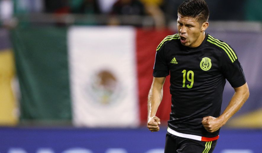 Mexico forward Oribe Peralta celebrates his goal against Cuba during the first half of a CONCACAF Gold Cup soccer match, Thursday, July 9, 2015, in Chicago. (AP Photo/Andrew A. Nelles)