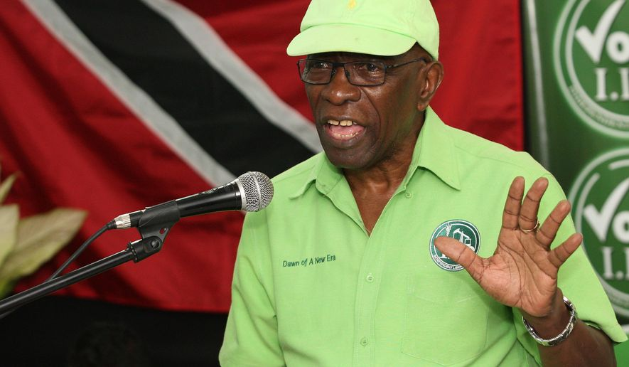 FILE - In this June 3, 2015 file photo, former FIFA vice president Jack Warner speaks at a political rally in Marabella, Trinidad and Tobago. A Trinidad judge has adjourned an extradition hearing for Warner until later this month. Warner's defense lawyer said Thursday, July 9, 2015, the hearing was adjourned because U.S. authorities have yet to send charges to Trinidad. A new hearing date of July 27 has been set. (AP Photo/Anthony Harris, File)