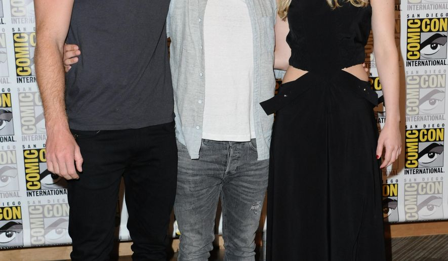 """Liam Hemsworth, from left, Josh Hutcherson, and Jennifer Lawrence attend """"The Hunger Games: Mockingjay Part 2"""" press line on day 1 of Comic-Con International on Thursday, July 9, 2015, in San Diego, Calif. (Photo by Richard Shotwell/Invision/AP)"""