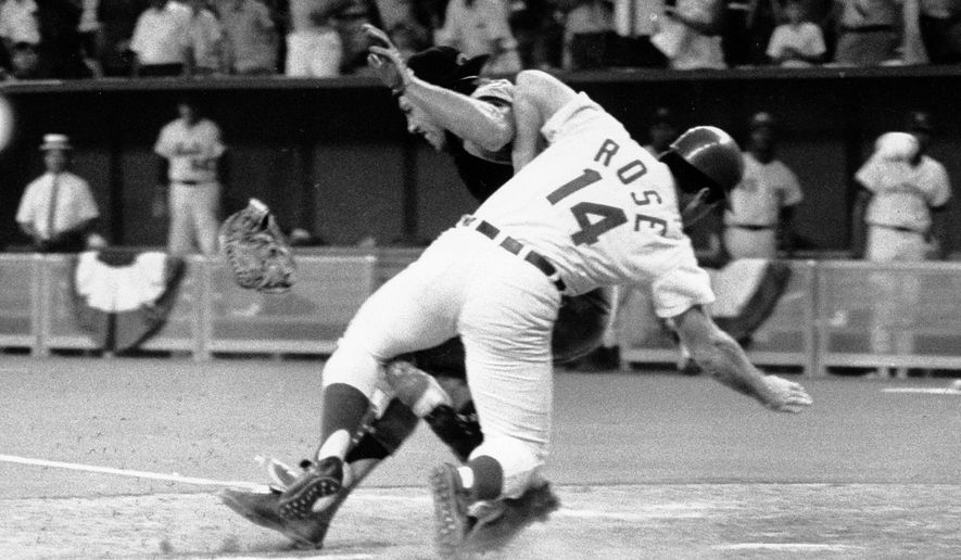 FILE - In this July 14, 1970, file photo, National League's Pete Rose collides with American League catcher Ray Fosse as he scores the winning run during the 12th inning of the 1970 All-Star Game in Cincinnati, Ohio. Fosse's body still aches all over 45 years later. He never did fully recover physically from one of most infamous plays in All-Star Game history. (AP Photo/File)