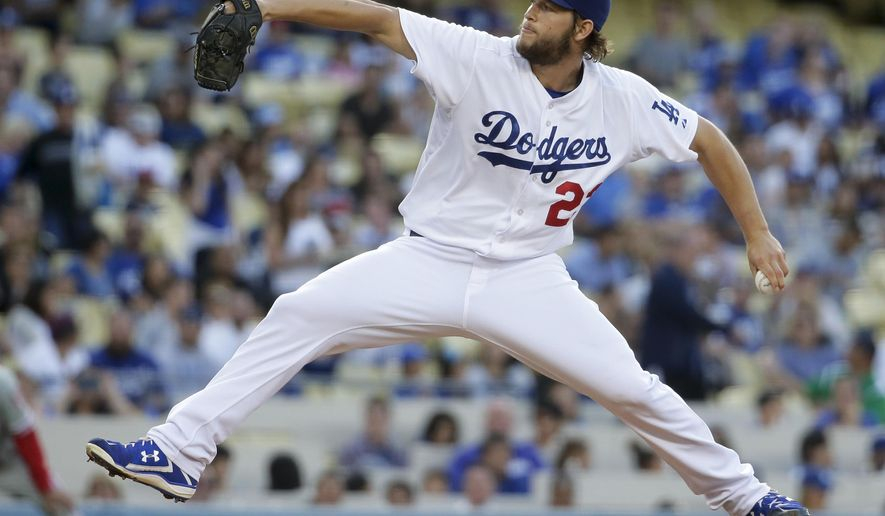 Los Angeles Dodgers starting pitcher Clayton Kershaw throws against the Philadelphia Phillies during the first inning of a baseball game in Los Angeles, Wednesday, July 8, 2015. (AP Photo/Chris Carlson)