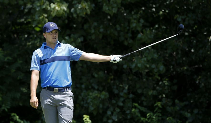 Jordan Spieth signals his tee shot hooked left on the second hole during the first round of the John Deere Classic golf tournament Thursday, July 9, 2015, in Silvis , Ill. (AP Photo/Charles Rex Arbogast)