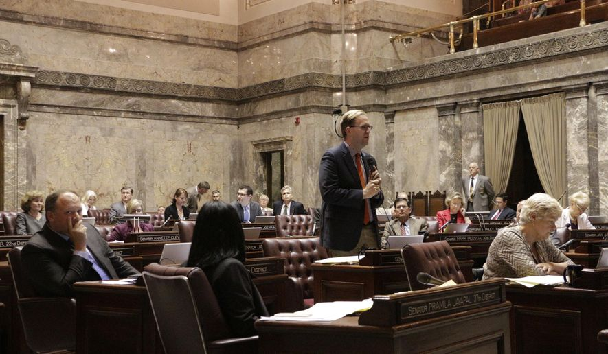 Democatic Sen. Marko Liias speaks against a measure that would delay full implementation of an initiative to reduce class sizes, Thursday, July 9, 2015, in Olympia, Wash. The measure was a key component to the state's new $38.2 billion operating budget. (AP Photo/Rachel La Corte)