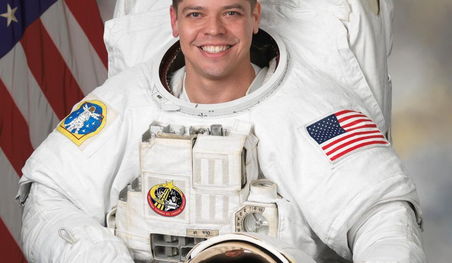 In this Oct. 22, 2007 photo provided by NASA, astronaut Robert Behnken poses for a photo. Behnken is one of four veteran astronauts selected to fly the first commercial space missions, NASA announced, Thursday, July 9, 2015. (NASA via AP)