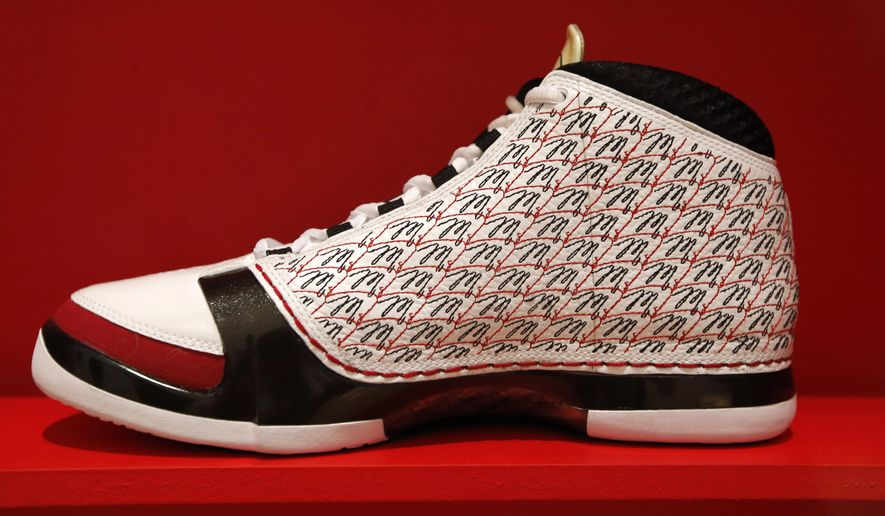 "A shoe from the Jordan collection, bearing the ""M"" from Michael Jordan's signature, is displayed as part of the ""Out of the Box: The Rise of Sneaker Culture"" exhibit at the Brooklyn Museum of Art in New York, Wednesday, July 8, 2015. The Jordan sneaker collection comprises a large part of the exhibit, which hopes to trace sneakers' role in social history from origins in the mid-nineteenth century to the present day. (AP Photo/Kathy Willens)"