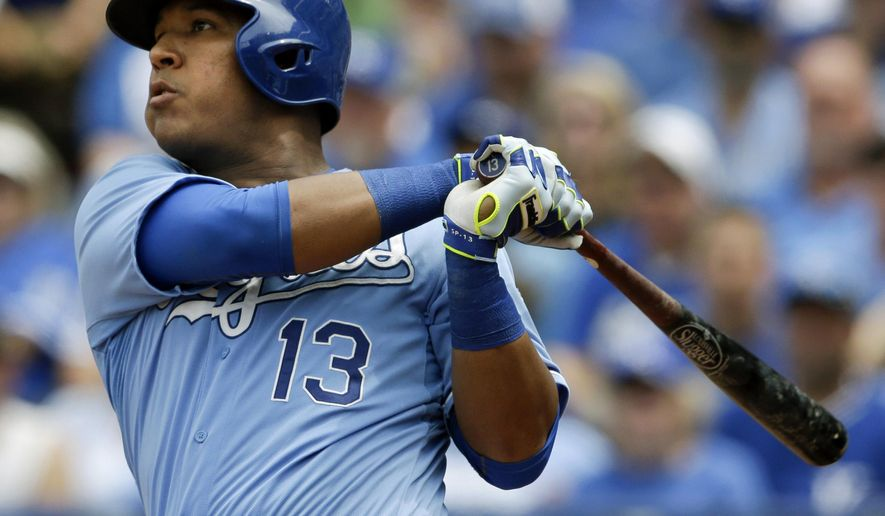 Kansas City Royals' Salvador Perez hits a two-run home run off Tampa Bay Rays starting pitcher Nathan Karns during the fifth inning of a baseball game at Kauffman Stadium in Kansas City, Mo., Thursday, July 9, 2015. (AP Photo/Orlin Wagner)