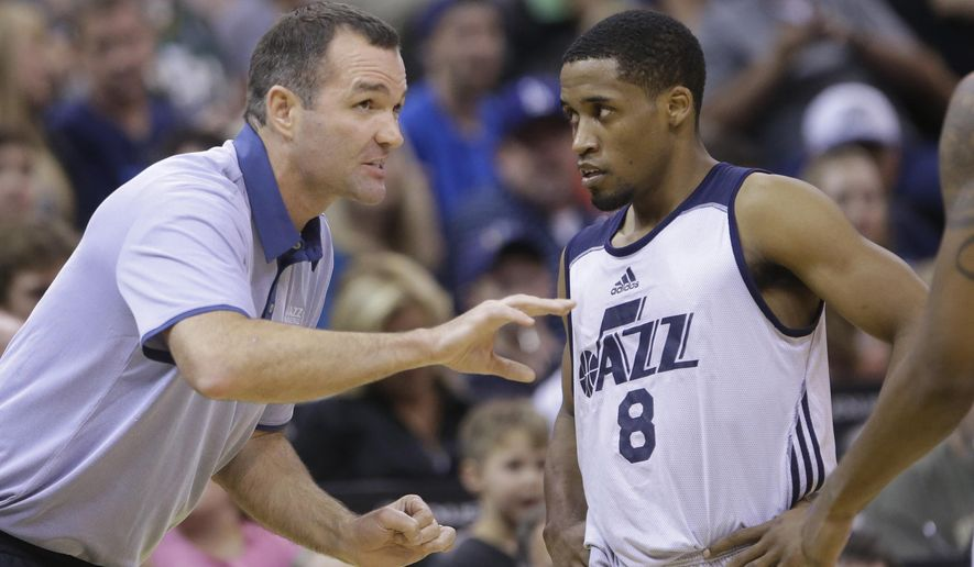 FILE - This Tuesday, July 7, 2015, file photo, shows Utah Jazz summer league head coach Alex Jensen speaking with Utah Jazz's Bryce Cotton (8) during the second half of an NBA summer league basketball game against the San Antonio Spurs, in Salt Lake City. (AP Photo/Rick Bowmer, File)