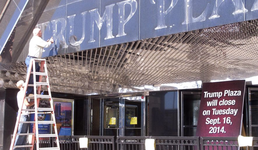 This Oct. 6, 2014 photo shows workers removing letters from the facade of the shuttered Trump Plaza casino in Atlantic City, N.J. On Thursday July 9, 2015, a Delaware bankruptcy judge approved a deed restriction that owner Trump Entertainment Resorts had placed on the shuttered gambling hall, preventing anyone from operating it as a casino for at least 10 years. (AP Photo/Wayne Parry)