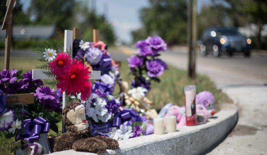 This Wednesday, July 1, 2015 photo shows a memorial to Sophia Archer at the corner of North First Street and West Sunset Drive in Riverton, Wyo. Sophia, 7, died May 22, after being struck by an elderly driver while crossing a crosswalk on her way home from school. (Ryan Dorgan/The Casper Star-Tribune via AP) MANDATORY CREDIT