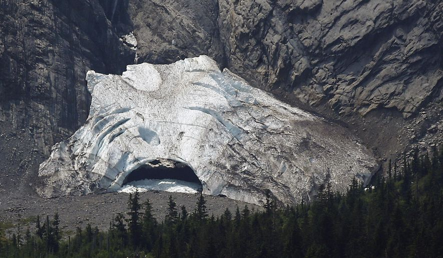 The Big Four Ice Caves in Washington are devoid of visitors Tuesday, July 7, 2015. On Tuesday, crews were trying to recover the body of a 34-year-old woman buried when rock and ice fell at the back of the cave. The ice caves area is prone to avalanches, falling rocks and ice, and visitors are urged not to leave the trail or enter the caves. (Mark Mulligan/The Herald via AP) MANDATORY CREDIT