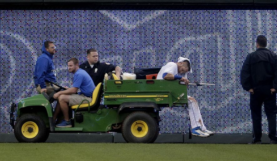 Kansas City Royals left fielder Alex Gordon is carted off the field after sustaining an injury while attempting to field an inside-the-park home run by Tampa Bay Rays' Logan Forsythe during the fourth inning of a baseball game Wednesday, July 8, 2015, in Kansas City, Mo. (AP Photo/Charlie Riedel)