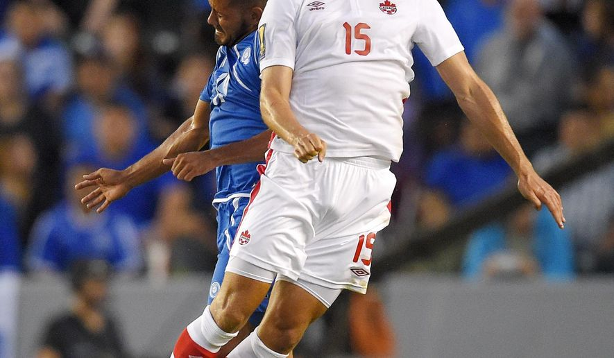 El Salvador's Irvin Herrera, left, and Canada's Adam Straith try to head the ball during the first half of a CONCACAF Gold Cup soccer match, Wednesday, July 8, 2015, in Carson, Calif. (AP Photo/Mark J. Terrill)