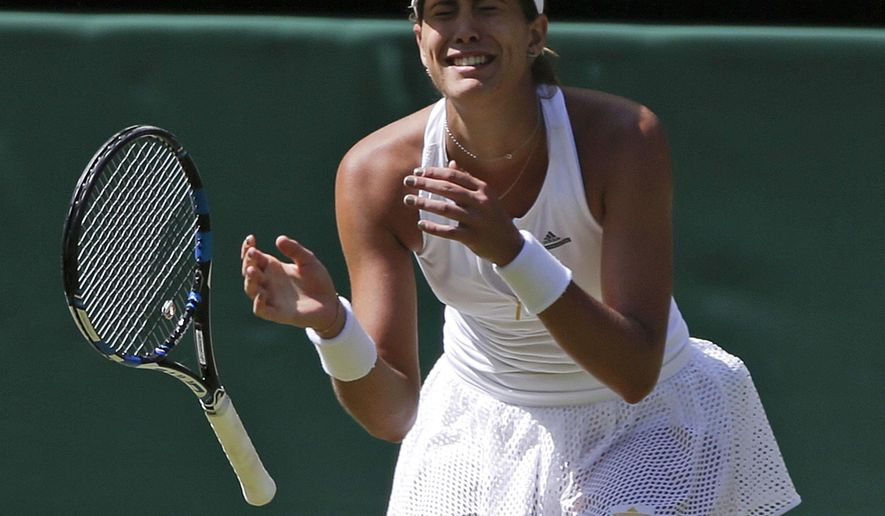 Garbine Muguruza of Spain celebrates after defeating Agnieszka Radwanska of Poland after their women's singles semifinal match at the All England Lawn Tennis Championships in Wimbledon, London, Thursday July 9, 2015. Muguruza won 6-3, 3-6, 6-3.(AP Photo/Pavel Golovkin)
