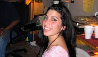 """Amy Winehouse appears in a scene from the film, """"Amy."""" Business manager Nick Shymansky helped director Asif Kapadia reconstructing the timeline of the singer's life, often piecing together the chanteuse's pre-fame life in the early 2000s. (Associated Press)"""