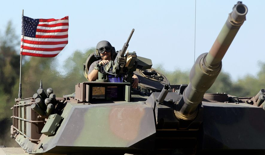 While the U.S. Army plans to begin trimming up to 40,000 soldiers from its ranks starting in October, military bases around the District of Columbia will mostly be spared from attrition. (Associated Press)