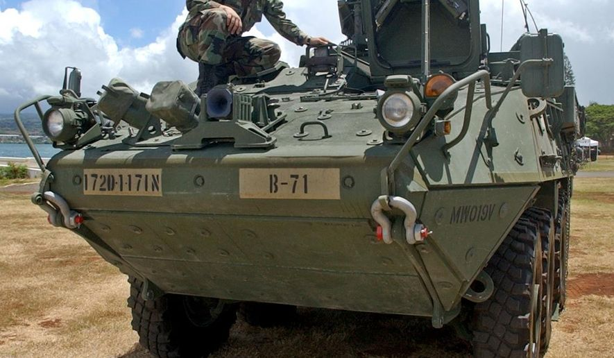 This July 26, 2004 file photo shows one of three of the Army's 19-ton Stryker combat vehicles unveiled during a public showing at Pearl Harbor, Hawaii. The Army says it will shrink the size of an Oahu-based unit and pull Stryker combat vehicles out of Hawaii as part of broader Army-wide cost-cutting plan, Thursday, July 9, 2015. (AP Photo/Lucy Pemoni, File)
