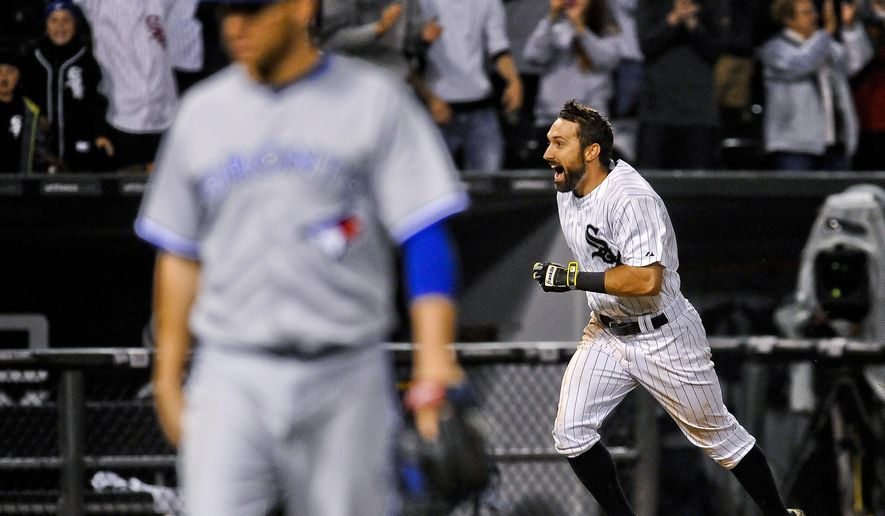 Chicago White Sox's Adam Eaton rounds third base after his home run against the Toronto Blue Jays during the 11th inning of a baseball game in Chicago on Wednesday, July 8, 2015.  The White Sox won 7-6. In the foreground is Toronto pitcher Roberto Osuna. (AP Photo/Matt Marton)