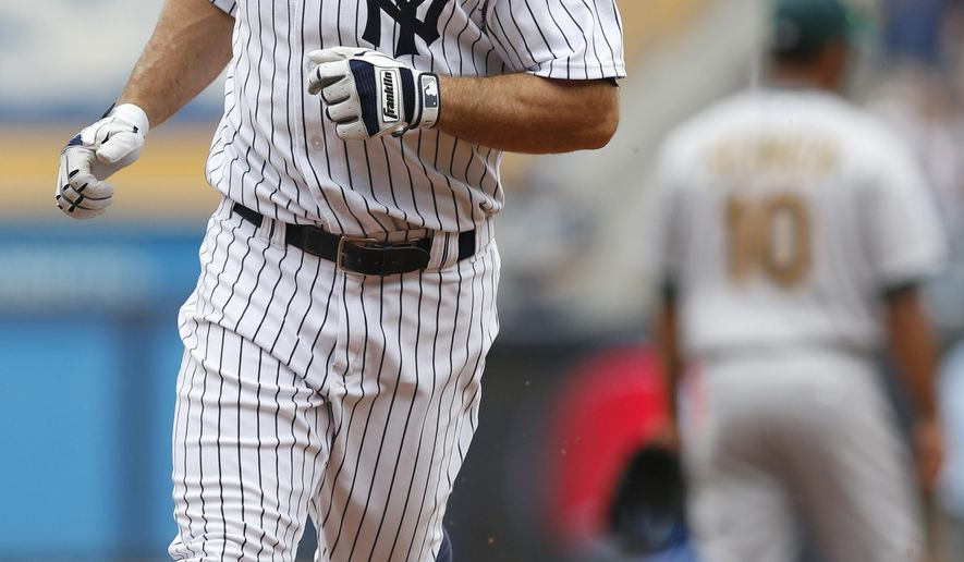New York Yankees' Brett Gardner runs on his first-inning solo home run in a baseball game against the Oakland Atheltics at Yankee Stadium in New York, Thursday, July 9, 2015.  (AP Photo/Kathy Willens)