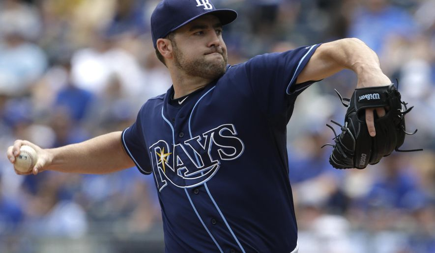 Tampa Bay Rays starting pitcher Nathan Karns delivers against the Kansas City Royals during the first inning of a baseball game, Thursday, July 9, 2015, in Kansas City, Mo. (AP Photo/Orlin Wagner)