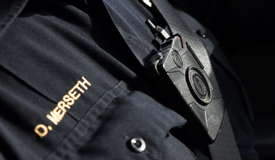 FILE - In this Feb. 2, 2015, file photo, Duluth police officer Dan Merseth patrols wearing his body camera in Duluth, Minn. Some Minnesota police chiefs plan to ask a state agency for temporary restrictions on access to police body camera video after failing to convince Minnesota lawmakers to limit public availability. (AP Photo/Jim Mone, File)