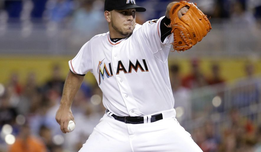 Miami Marlins starting pitcher Jose Fernandez winds up during the first inning of a baseball game against the Cincinnati Reds, Thursday, July 9, 2015,, in Miami. (AP Photo/Lynne Sladky)
