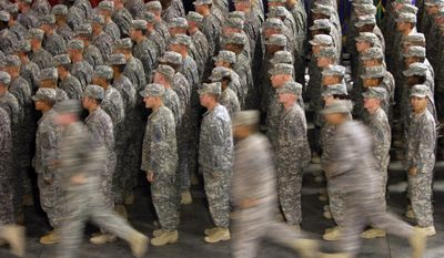 In this Sept. 22, 2009, file photo, members of the U.S. Army's 1st Infantry Division fall in for a re-deployment ceremony upon return from Iraq to Fort Riley, Kan. (AP Photo/Orlin Wagner, File)