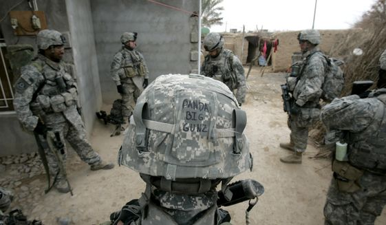 """U.S. army soldiers from Ghostrider Company, 3rd Squadron, 2nd Stryker Cavalry Regiment take a break after searching a house during Operation Phantom Phoenix in the village of Abu Musa on the northern outskirts of Muqdadiyah, in the volatile Diyala province, about 90 kilometers (60 miles) north of Baghdad, Iraq, Thursday, Jan. 10, 2008. Facing another decision about U.S. troop levels in Iraq by spring, U.S. President Bush said Saturday Jan. 12, 2008 it's """"fine with me"""" if generals recommend no more reductions than those already planned to take the force posture down to about 130,000.(AP Photo/Marko Drobnjakovic)"""