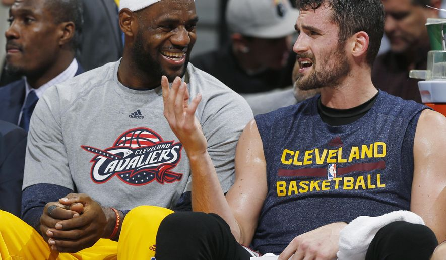 "FILE - In this Nov. 7, 2014, file photo, Cleveland Cavaliers forwards LeBron James, left, and Kevin Love joke with each other on the bench in the fourth quarter of the Cavaliers' 110-101 victory over the Denver Nuggets in an NBA basketball game in Denver. Forward Kevin Love says he and superstar LeBron James had a ""very honest"" talk before he decided to re-sign as a free agent with the Cavaliers. Love announced he was returning last week and said Thursday, July 9, 2015, that his new five-year, $113.2 million contract with Cleveland is ""inked and official.""  (AP Photo/David Zalubowski, File)"