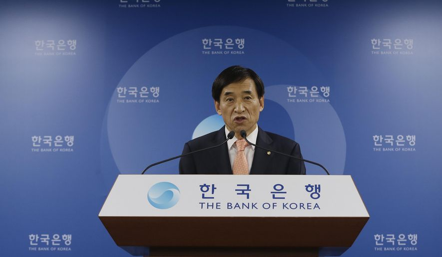 Governor of the Bank of Korea Lee Ju-yeol speaks during a press conference on the benchmark interest rate at the bank's headquarters in Seoul, South Korea, Thursday, July 9, 2015. South Korea's central bank cut its economic growth forecast, citing a severe drought and the spread of Middle East respiratory syndrome.(AP Photo/Ahn Young-joon)