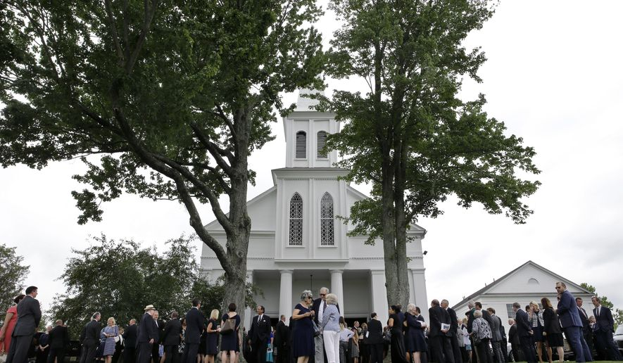 A large crowd spills onto the lawn at Lamington Presbyterian Church, during funeral services for John Whitman, husband of former New Jersey Gov. Christie Whitman Thursday, July 9, 2015, in Bedminster, N.J. A spokesman for the former Republican governor said the state's first-ever first gentleman died July 2 at Morristown Medical Center after suffering a catastrophic brain injury in mid-June. He was 71. John Whitman was an investment banker and a managing partner at Princeton-based Sycamore Ventures. (AP Photo/Mel Evans)