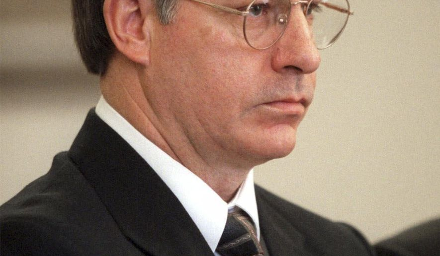 FILE - In this file photo from  Oct. 19, 2000, Robert L. Yates Jr. pleads guilty to 13 murders in a courtroom in Spokane, Wash.  The Washington Supreme Court has again rejected an effort by serial killer Yates to overturn his conviction and death sentence. Yates contends he received ineffective counsel during his 2002 trial in which he received the death penalty. His conviction and sentence were affirmed by the high court in 2007. (AP Photo/Jackie Johnston, File)