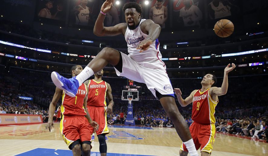 FILE - In this May 10, 2015, file photo, Los Angeles Clippers center DeAndre Jordan, second from right, celebrates after dunking as Houston Rockets forward Trevor Ariza, left, Josh Smith, second from left, and guard Pablo Prigioni, of Argentina, watch during the first half in Game 4 of a second-round NBA basketball playoff series in Los Angeles. DeAndre Jordan gave the Dallas Mavericks his word. Then he gave the Los Angeles Clippers his signature.  After a Clippers contingent including Blake Griffin, J.J. Redick, Paul Pierce and Doc Rivers descended on Jordan's home in Houston on Wednesday night, July 8, 2015,  for a last-ditch push to keep their defensive pillar, Jordan backed out of a verbal agreement with the Mavericks to stay with the only NBA home he's ever had. The Clippers announced Jordan's deal late Wednesday night. It's a four-year pact worth more than $87 million, a person with knowledge of the agreement told The Associated Press. (AP Photo/Jae C. Hong, File)