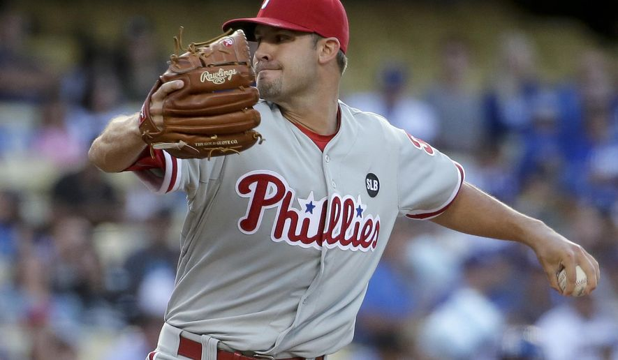 Philadelphia Phillies starting pitcher Adam Morgan throws against the Los Angeles Dodgers during the first inning of a baseball game in Los Angeles, Wednesday, July 8, 2015. (AP Photo/Chris Carlson)