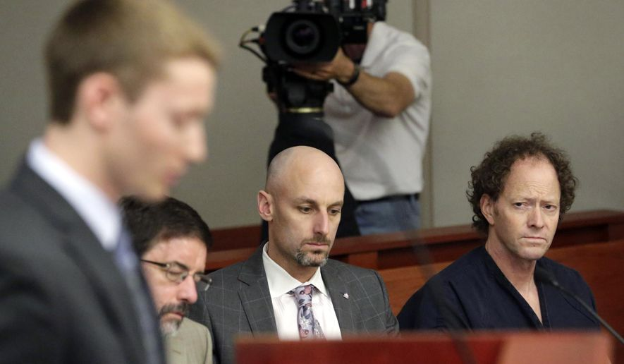 John Brickman Wall, right, a Salt Lake City pediatrician, looks on while his son Pelle Wall speaks during a hearing Wednesday, July 8, 2015, in Salt Lake City. John Brickman Wall was convicted of killing his cancer researcher ex-wife amid a bitter custody dispute and given a sentence of 15 years to life by state Judge James Blanch. (AP Photo/Rick Bowmer, Pool)