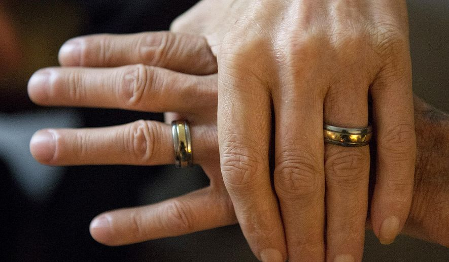 ADVANCE FOR USE SUNDAY, JULY 12 AND THEREAFTER - In this May 27, 2015 photo, Eddie Salter and Michael Smith show off their titanium and gold wedding rings at home in Carbondale, Ill. The two have been together for nearly 50 years. (Byron Hetzler/The Southern via AP)