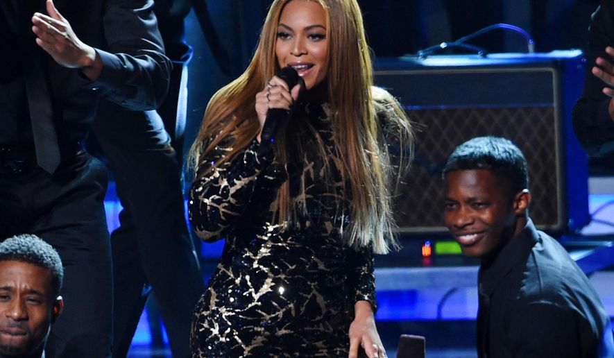 "FILE - In this Feb. 10, 2015, file photo, Beyonce performs at ""Stevie Wonder: Songs in the Key of Life - An All-Star Grammy Salute,"" at the Nokia Theatre L.A. Live in Los Angeles. Beyonce, Pearl Jam and Coldplay will perform at the 2015 Global Citizen Festival in New York's Central Park in September. (Photo by Chris Pizzello/Invision/AP, File)"