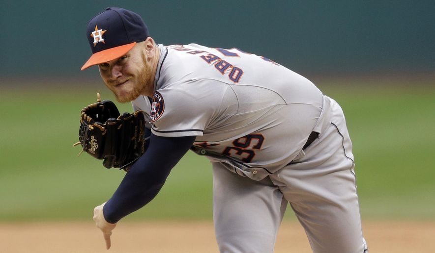 Houston Astros starting pitcher Brett Oberholtzer delivers in the first inning of a baseball game against the Cleveland Indians, Thursday, July 9, 2015, in Cleveland. (AP Photo/Tony Dejak)
