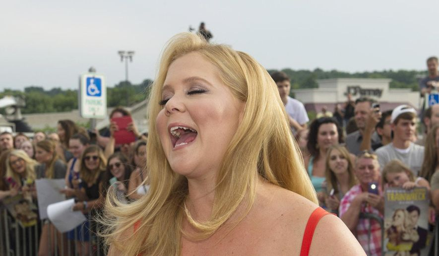 "Actress Amy Schumer reacts to a question as she talks to reporters at a special screening of the new comedy, ""Trainwreck"" at the Regal Cinemas Montrose Stadium 12 theaters, on Friday, July 10, 2015, in Akron, Ohio. Basketball player LeBron James is hosting the screening of the film that he co-stars in with Schumer and Bill Hader. (Photo by Phil Long/Invision/AP)"