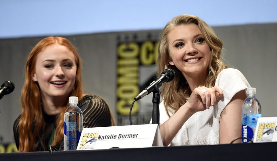 """Sophie Turner, left, and Natalie Dormer attend the """"Game of Thrones"""" panel on day 2 of Comic-Con International on Friday, July 10, 2015, in San Diego, Calif. (Photo by Chris Pizzello/Invision/AP)"""