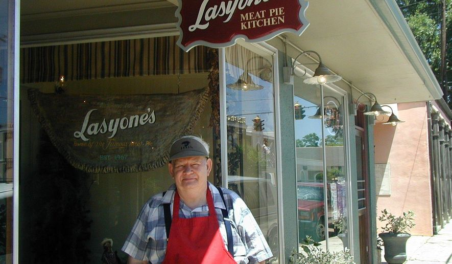 FOR RELEASE SATURDAY, JULY 11, 2015, AT 12:02 A.M. CDT. - In this photo taken on in 2002, James Lasyone stands in front of his business, Lasyone's Meat Pie Kitchen, in downtown Natchitoches, La. When Lasyone died June 25, 2015, at the age of 84, he left his family and the town of Natchitoches with a legacy of great food — especially his famous meat pies — and a restaurant that bears his name.  (Carita Jordan/The Daily Town Talk via AP)  NO SALES; MANDATORY CREDIT