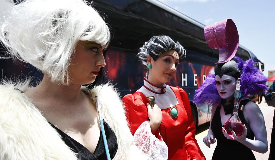Fans wear costumes at the convention center on opening day of the 2015 Comic-Con International Thursday, July 9, 2015, in San Diego. The pop-culture event held at the San Diego Convention Center runs July 9-12. (AP Photo/Lenny Ignelzi)