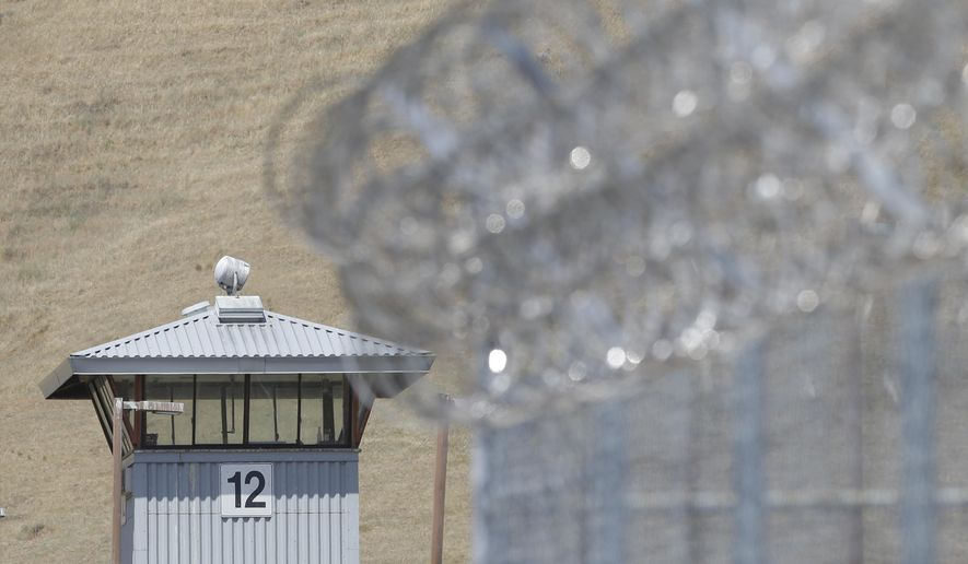 In this photo taken Wednesday May 20, 2015, a guard tower and razor wire are seen at California State Prison, Solano in Vacaville, Calif. (AP Photo/Rich Pedroncelli)