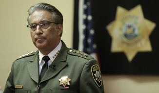 FILE - In this Monday, July 6, 2015, file photo, San Francisco Sheriff Ross Mirkarimi fields questions during an interview in San Francisco. Mirkarimi was already fighting for his political life. Then his jail released a Mexican national wanted by federal immigration authorities who wanted to deport the man for the sixth time. The jail's decision to release Juan Francisco Lopez-Sanchez,  who is charged with randomly shooting to death a young San Francisco woman shortly after his release, has placed Mirkarimi squarely in the center of a national debate over immigration. (AP Photo/Ben Margot, File)
